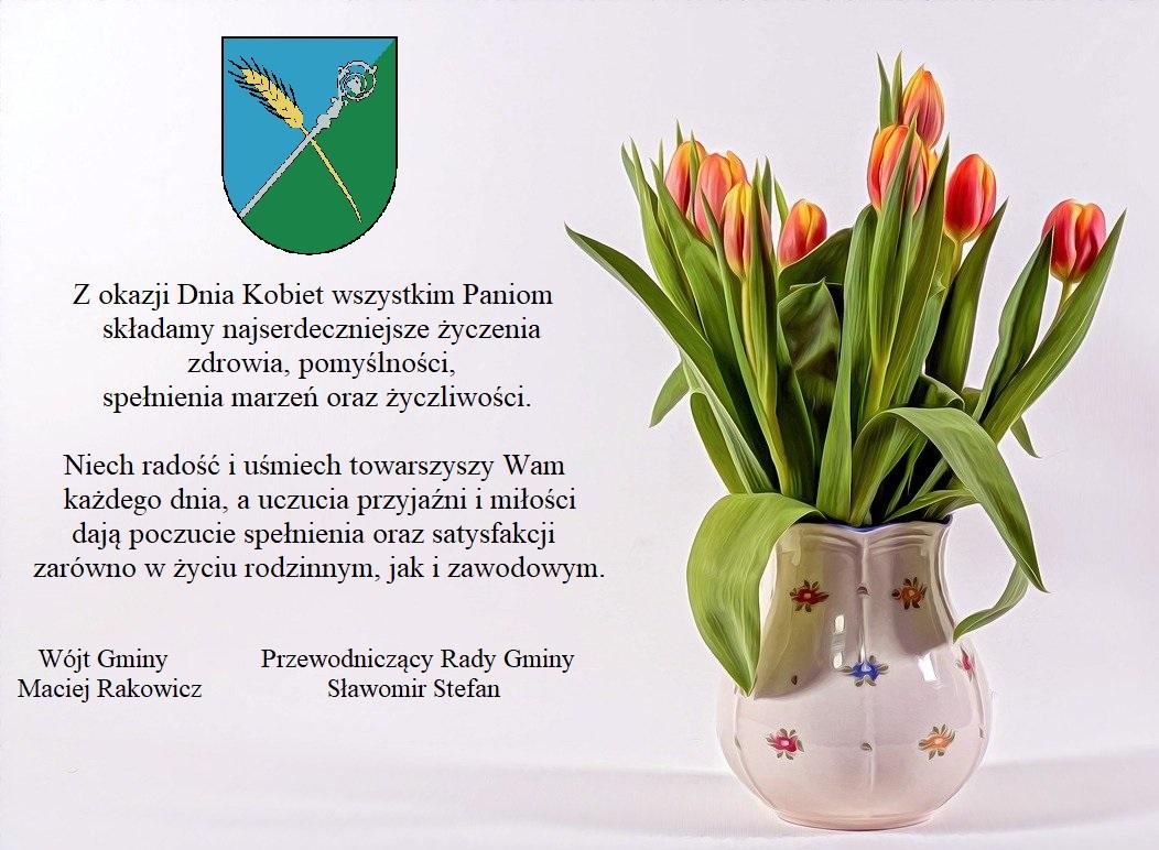 Na obrazku znajduje się bukiet kwiatów w wazonie, logo Gminy i życzenia tekstowe